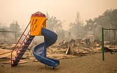 A playground is surrounded by smoldering rubble while firefighters continue to battle the Valley fire in Middletown California on September 13 2015...