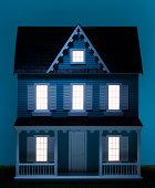 Playhouse with illuminated windows, close-up