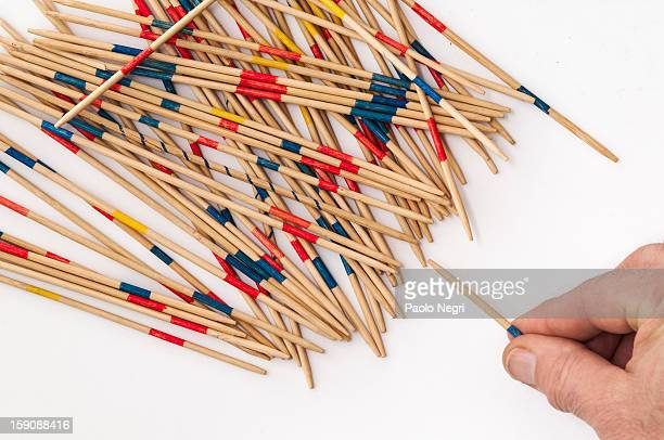 Playing a game of pick-up sticks