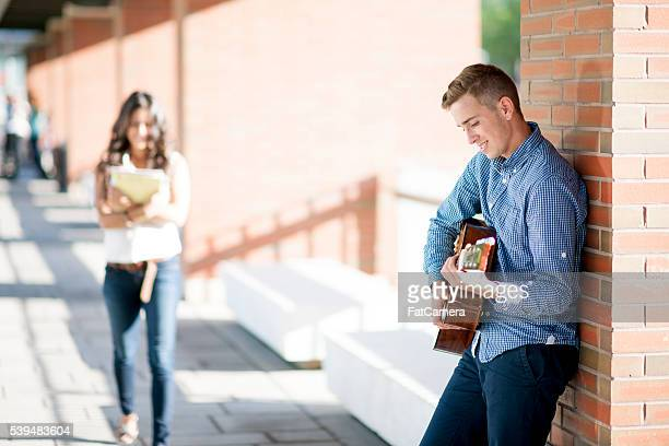 Playing a Song on a Guitar