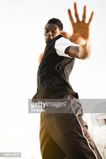 Playing a tough basketball game. : Stock Photo