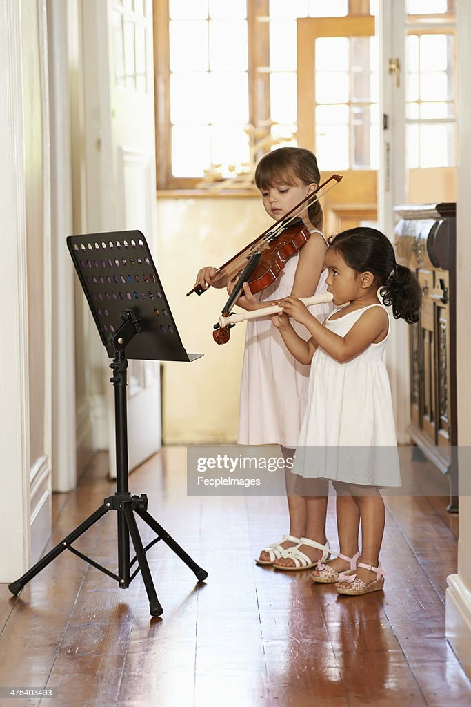 Playing a violin duet