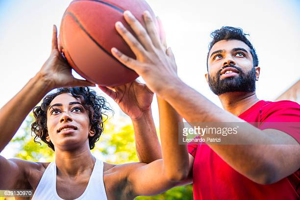 Playing and teaching at basketball court