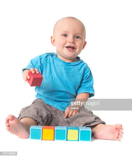 playing Baby isolated on white building bricks toys copyspace