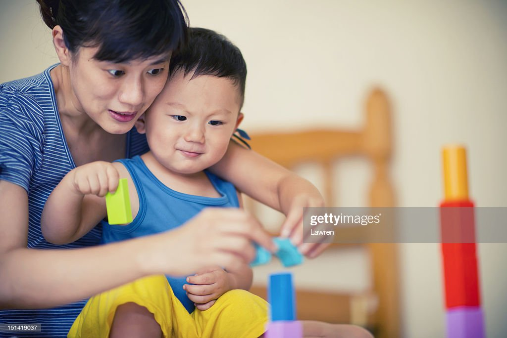 Playing building blocks in room : Stock Photo