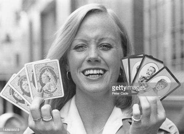 Playing card researcher and designer Avril Walsh of the Waddington's game company holding playing cards commemorating the Diamond Jubilee of Queen...