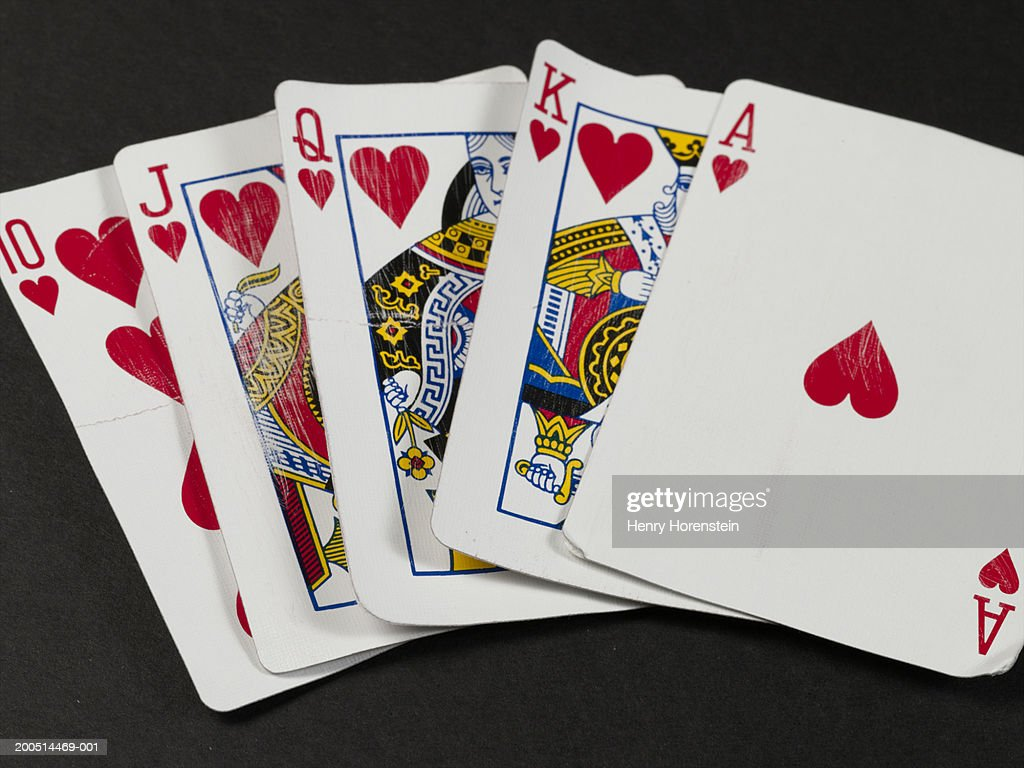 Playing cards in poker hand : Stock Photo
