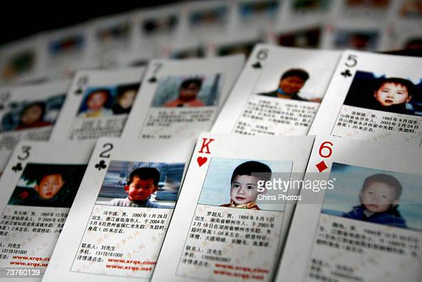 Playing cards showing details of missing children are displayed on March 31 2007 in Beijing China The cards showing photographs and information of 27...