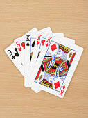 Playing cards showing full house, close up