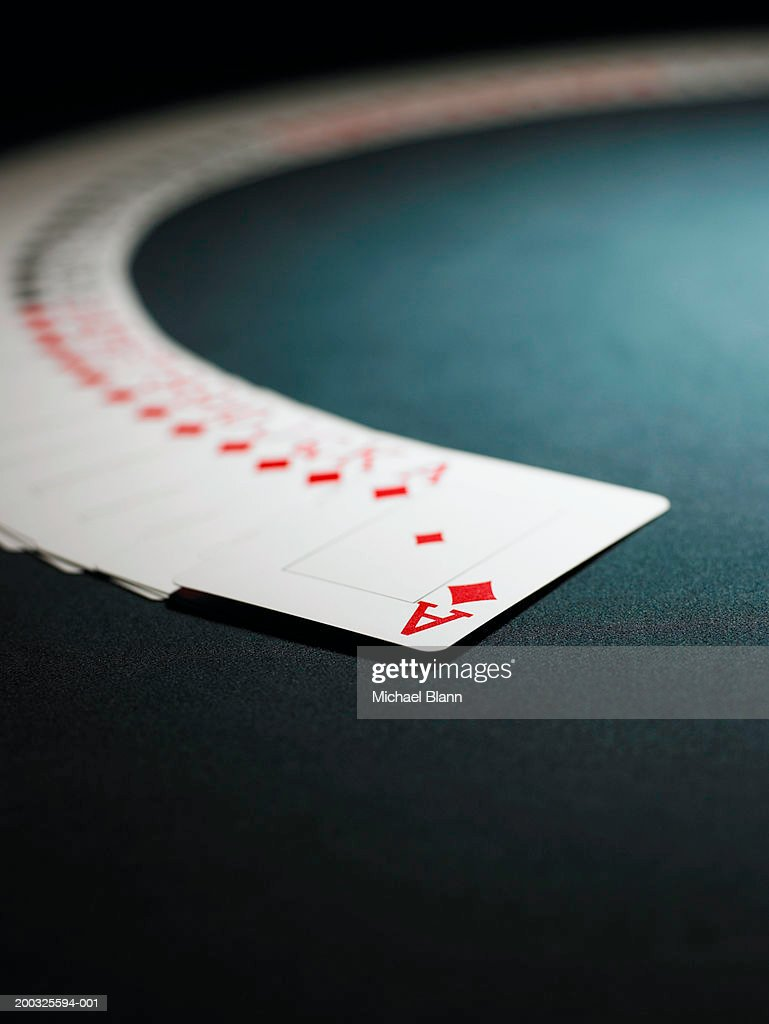 Playing cards spread out in arc from ace of diamonds : Stock Photo