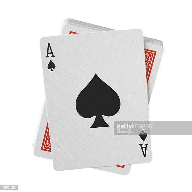 Playing cards with ace of spades facing up