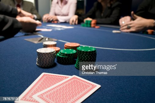 Playing cards with stacks of gambling chips on a casino table