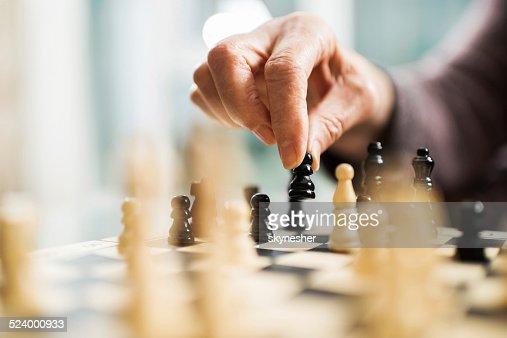 Playing chess.