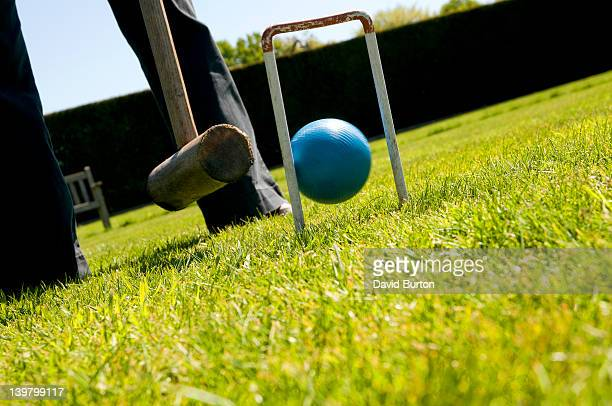Playing croquet on garden lawn, Norfolk, England