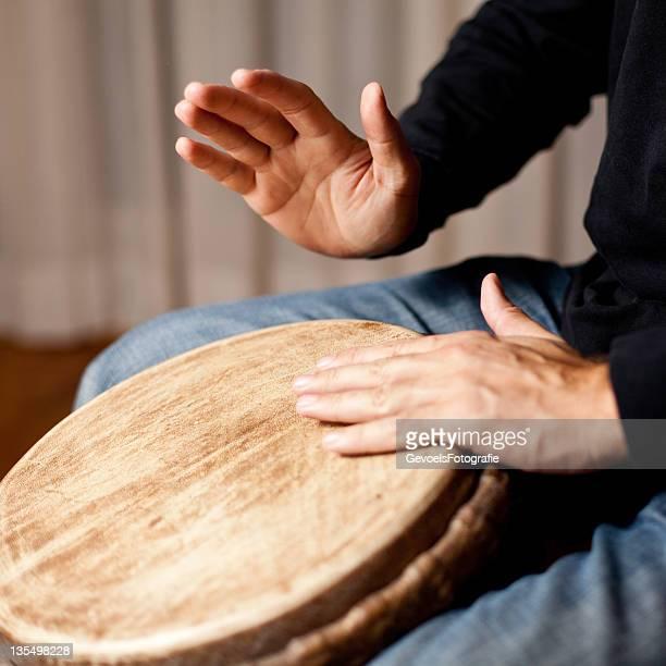 Playing djembe drum