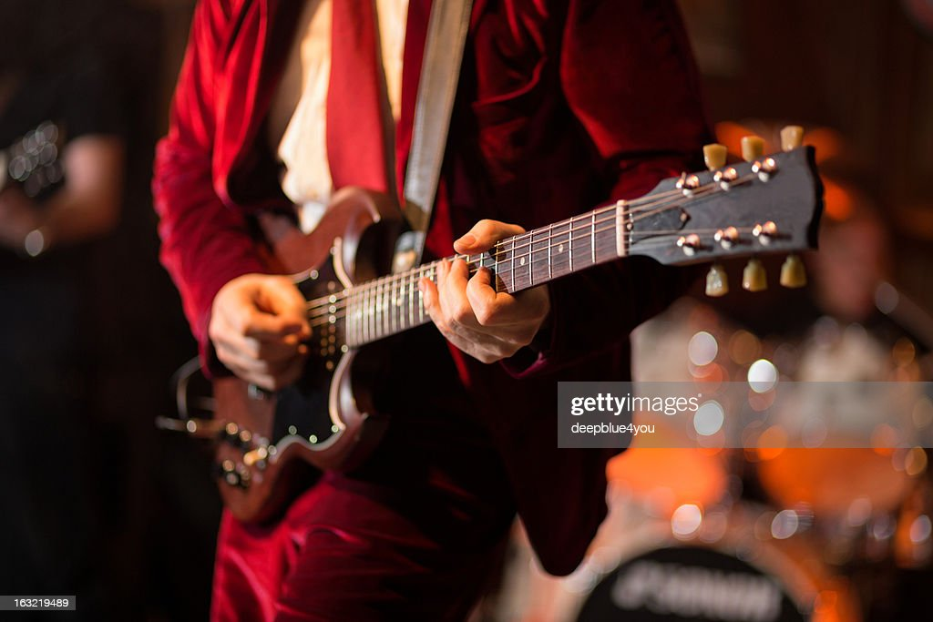 Playing electric guitar on stage