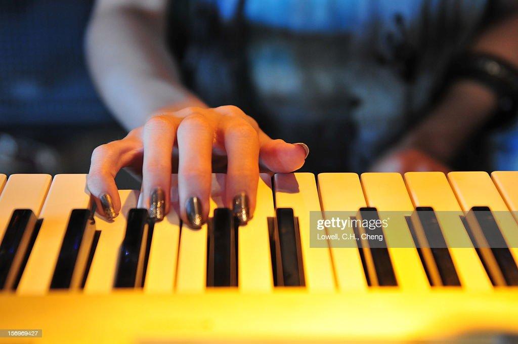 Playing Electronic Piano : Stock Photo