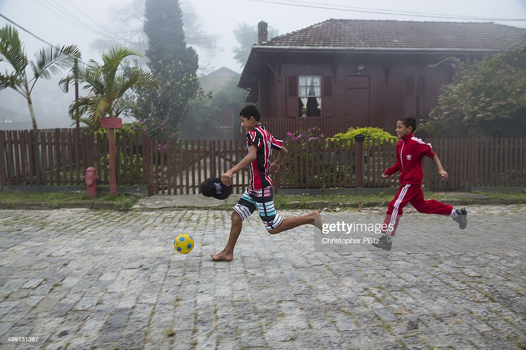 Playing football on a misty day : Stock-Foto