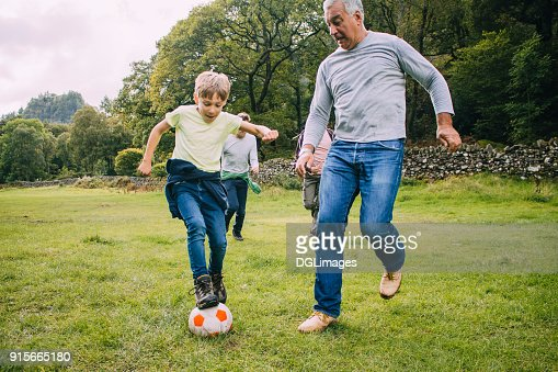 Playing Football With Grandad : Foto de stock