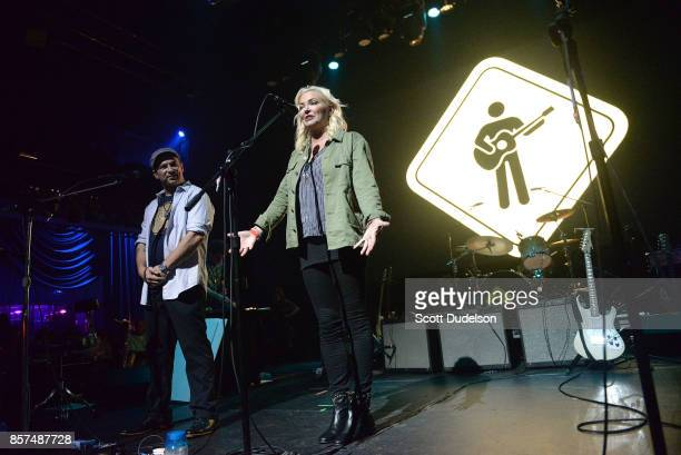 Playing for Change founders Mark Johnson and Whitney Kroenke appear onstage during the We are One Benefit concert at The Mayan on October 3 2017 in...