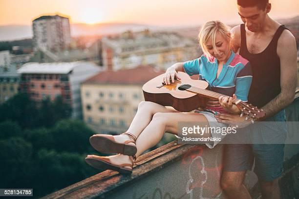 Spielt Gitarre für die Stadt