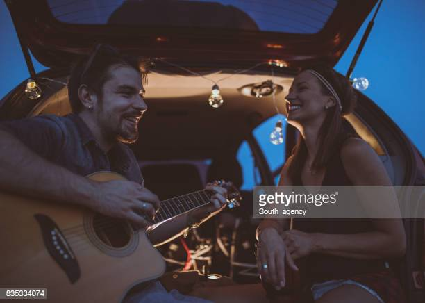 Playing guitar on a romantic date