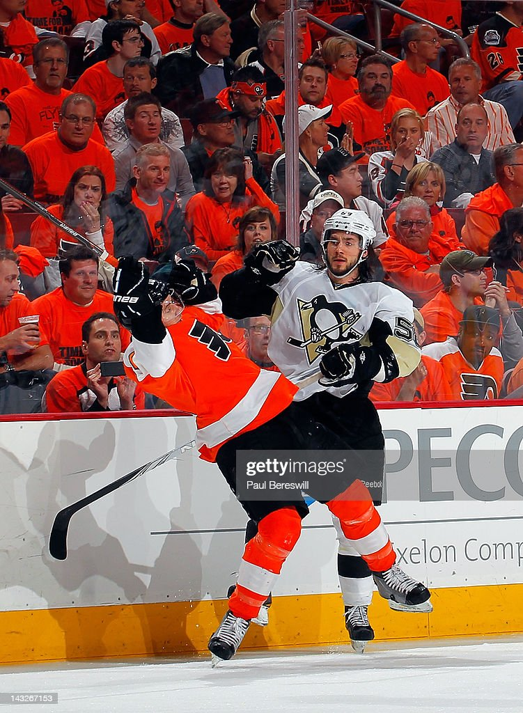 Playing in front of fans dressed in orange, <a gi-track='captionPersonalityLinkClicked' href=/galleries/search?phrase=Kris+Letang&family=editorial&specificpeople=3966336 ng-click='$event.stopPropagation()'>Kris Letang</a> #58 of the Pittsburgh Penguins checks <a gi-track='captionPersonalityLinkClicked' href=/galleries/search?phrase=Brayden+Schenn&family=editorial&specificpeople=4782304 ng-click='$event.stopPropagation()'>Brayden Schenn</a> #10 of the Philadelphia Flyers to the ice in the second period of Game Six of the Eastern Conference Quarterfinals during the 2012 NHL Stanley Cup Playoffs at Wells Fargo Center on April 22, 2012 in Philadelphia, Pennsylvania. Flyers won the game 5-1 to eliminate the Penguins from the playoffs.