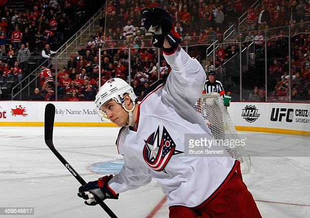 Playing in his 100th NHL game Cam Atkinson of the Columbus Blue Jackets scores the game winning goal during the shootout against the New Jersey...