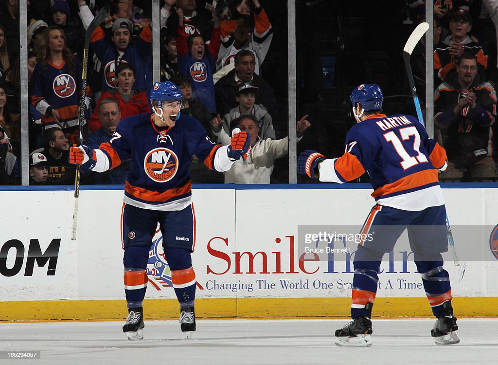 Playing in his first NHL game, Anders Lee #27 of the New York Islanders scores his first NHL goal against the Winnipeg Jets at 16:13 of the first period at the Nassau Veterans Memorial Coliseum on April 2, 2013 in Uniondale, New York.