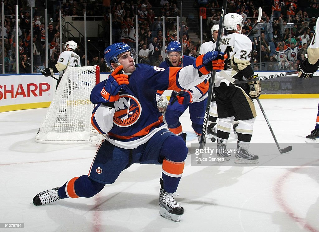Playing in his first NHL game, <a gi-track='captionPersonalityLinkClicked' href=/galleries/search?phrase=John+Tavares&family=editorial&specificpeople=601791 ng-click='$event.stopPropagation()'>John Tavares</a> #91 of the New York Islanders celebrates after scoring his first NHL goal against the Pittsburgh Penguins at the Nassau Coliseum on October 3, 2009 in Uniondale, New York.