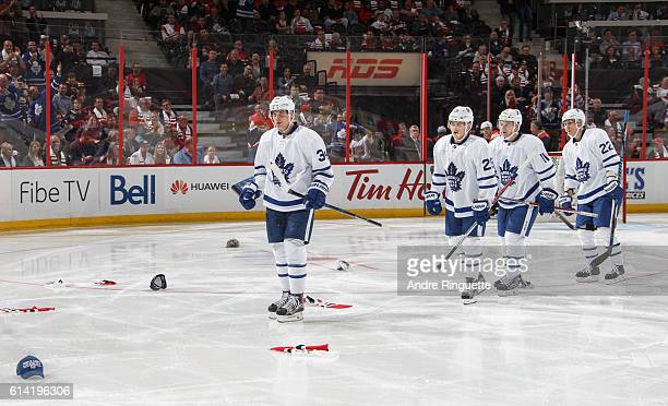 Playing in his NHL debut Auston Matthews of the Toronto Maple Leafs scores his third goal of the game and celebrates his first career NHL hat trick...