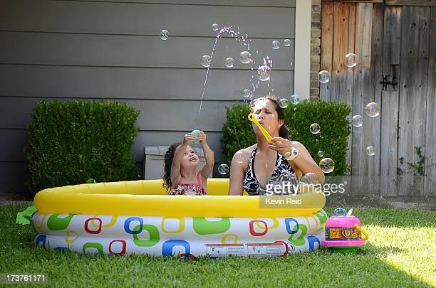 Playing in kiddie pool