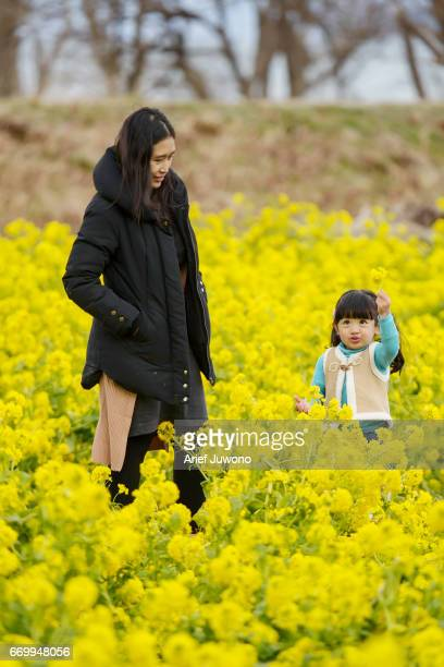 Playing in Rape Field with Mother