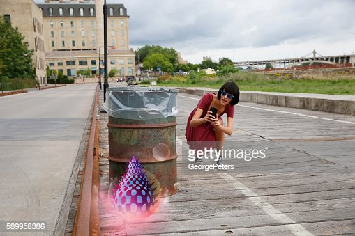 Playing Mobile Games On The Street