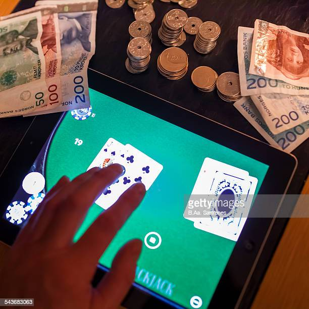 Playing online Norwegian money and a digital tablet The norwegian currency is called kroner