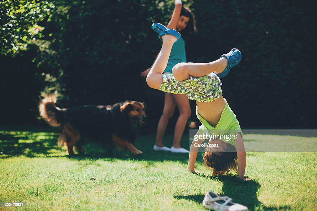 Playing outdoors somersaults