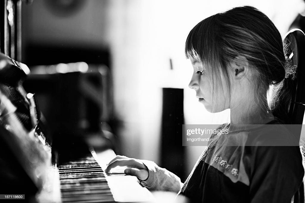 Playing piano : Stock Photo