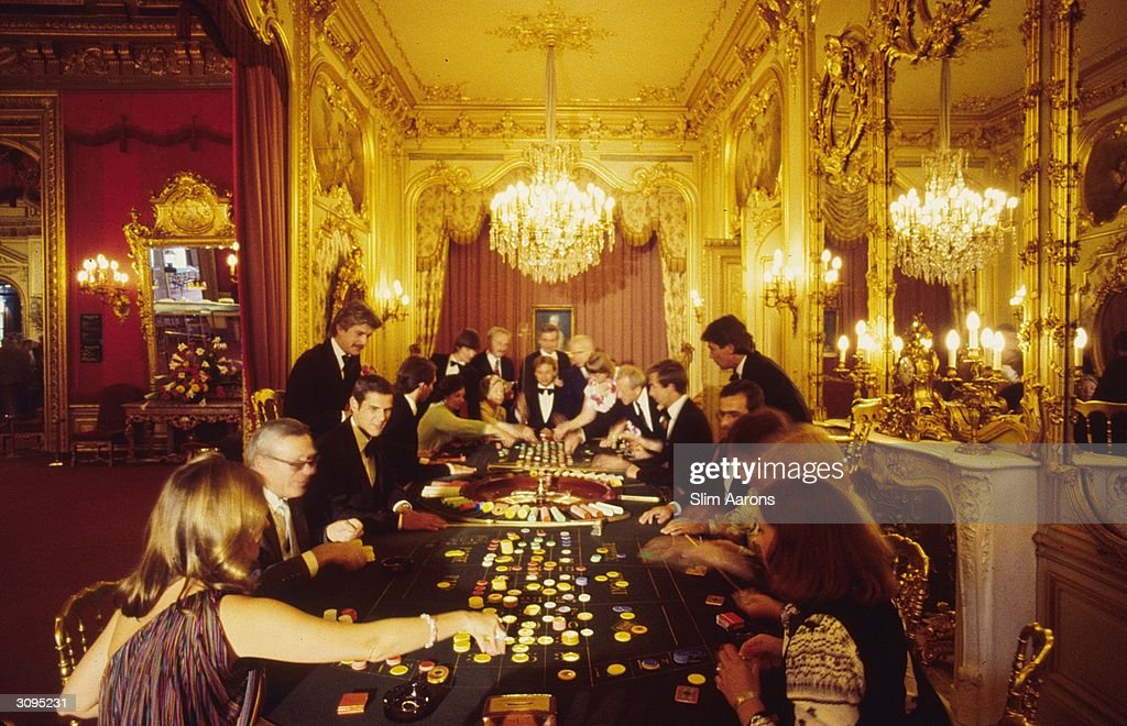 Playing roulette in the luxury casino at Baden-Baden, south west Germany.