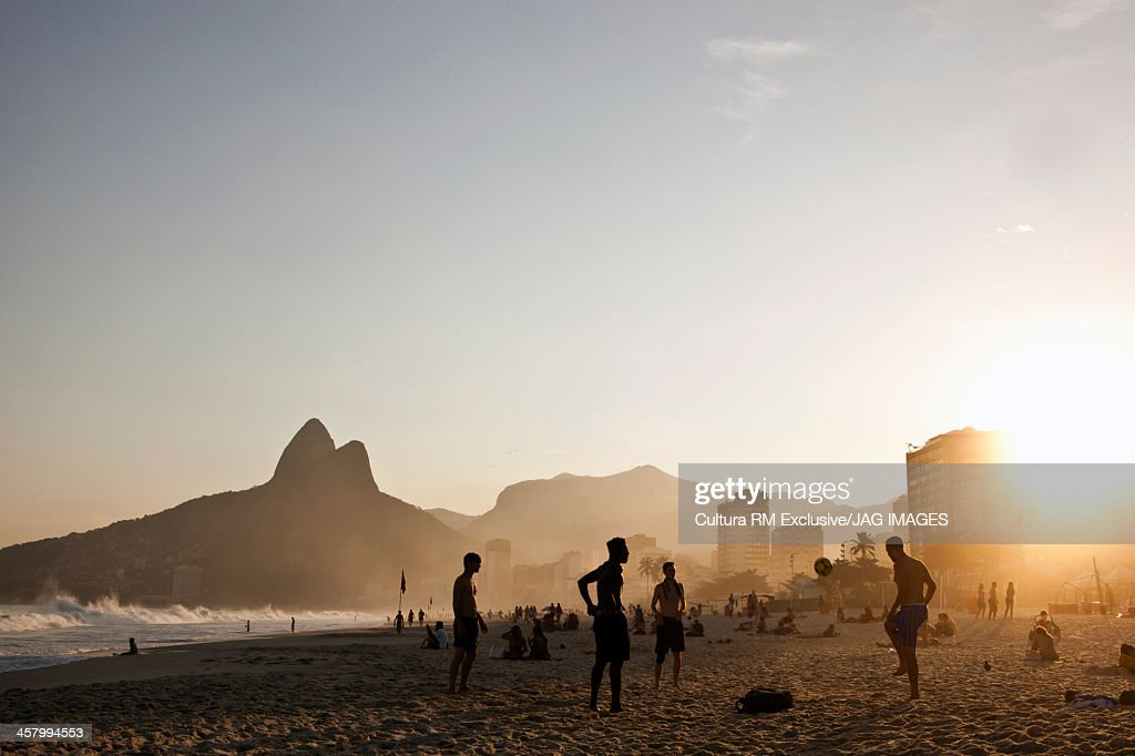 Playing soccer at sunset on Ipanema beach, Rio de Janeiro, Brazil