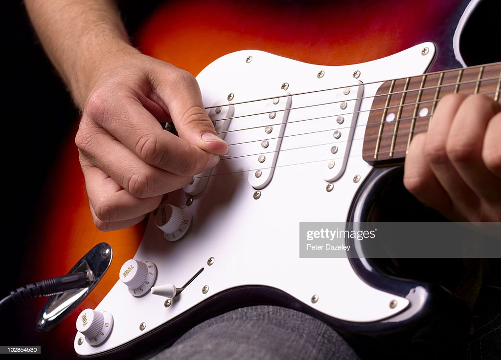 Playing solid electric guitar close up : Stock Photo