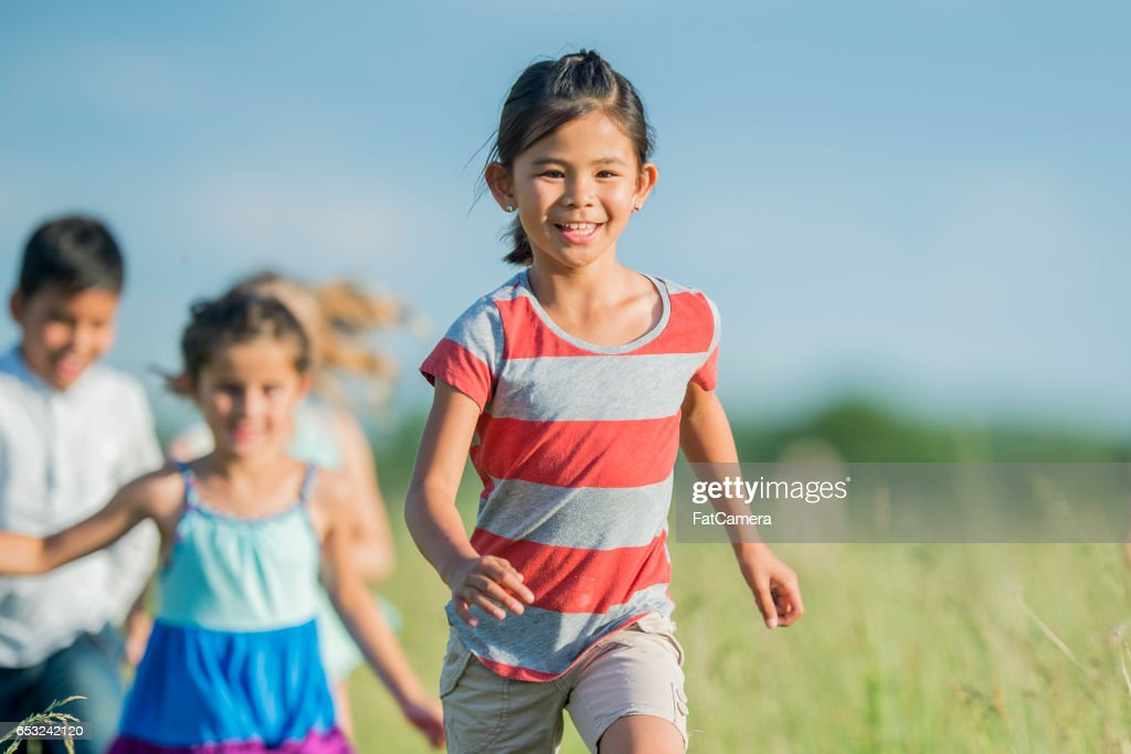 Playing Tag Outside at the Park : Stock Photo