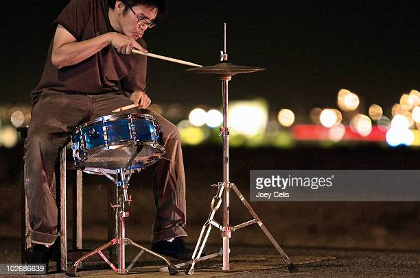 Playing the drums in the street.