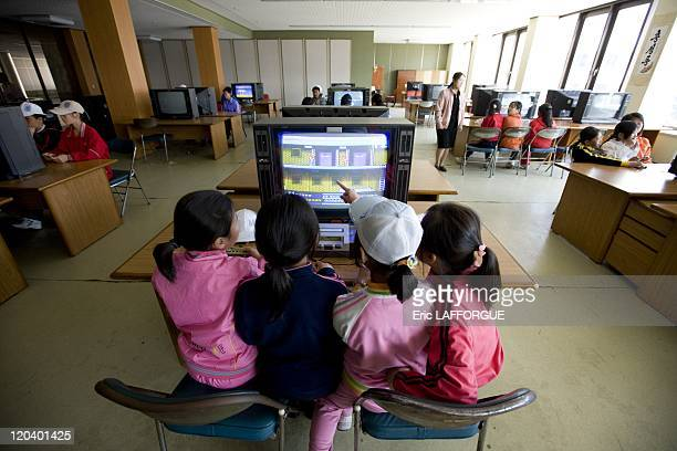 Playing Video Games In Songdowon Camp in North Korea Songdowon international holiday children's camp They play on Micro Genius computer game In the...