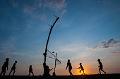 Silhouette of people playing volleyball at beach in Lombok, Indonesia