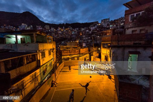 Playing Volley-football in favela