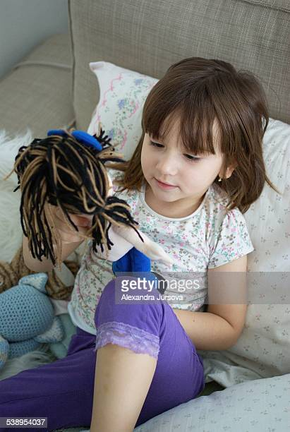 Playing with a doll