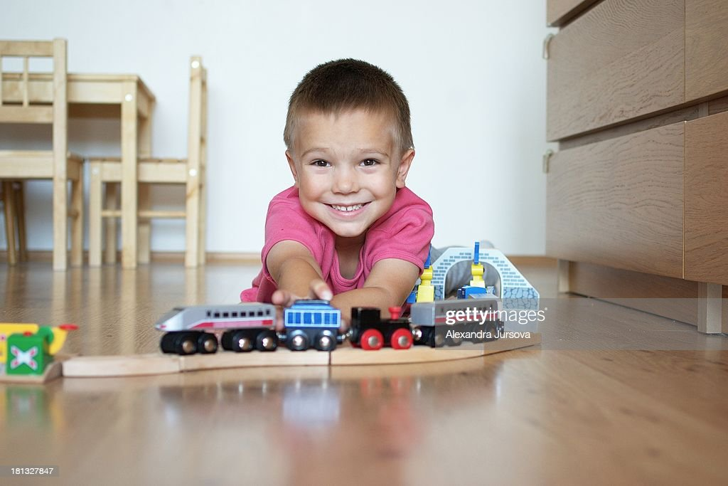 Playing with a wooden train