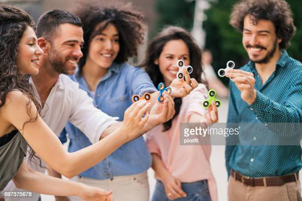 Playing with fidget spinners