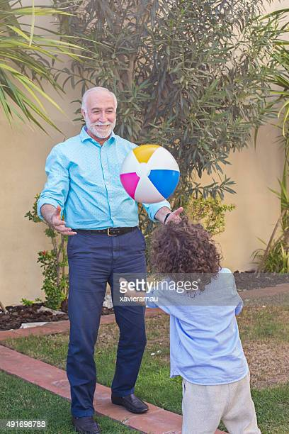 Playing with his grandson