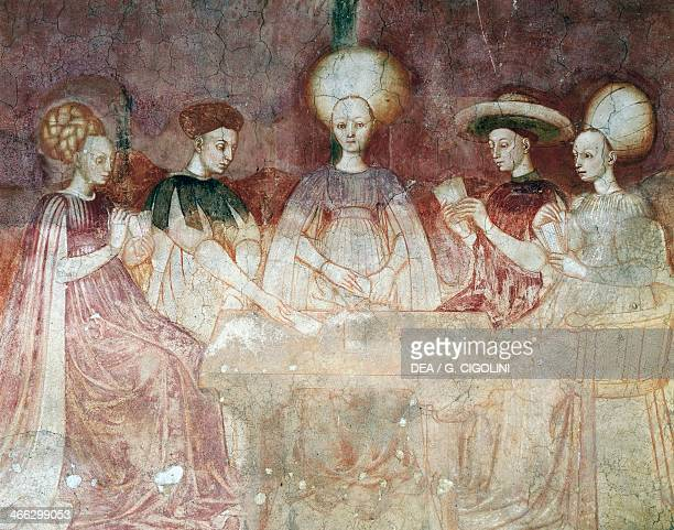 Playing with tarot cards scene from the Games cycle ca 14451450 fresco Palazzo Borromeo Milan Lombardy Italy 15th century